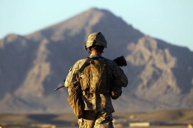 A U.S. Marine from the First Battalion Eighth Marines Alpha Company patrols in the town of Nabuk in southern Afghanistan's Helmand province, October 31, 2010. REUTERS/Finbarr O'Reilly (AFGHANISTAN - Tags: CONFLICT CIVIL UNREST MILITARY)